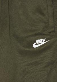 Nike Sportswear - REPEAT - Pantalones deportivos - khaki/white - 2
