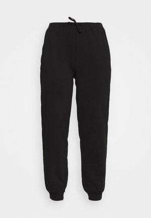 PCROKKA PANTS LOUNGE - Tracksuit bottoms - black