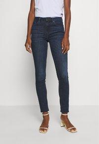 Tommy Hilfiger - COMO  - Jeans Skinny Fit - dark-blue denim - 0