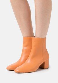 RAID - KLARA - Classic ankle boots - orange - 0