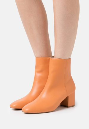 KLARA - Classic ankle boots - orange
