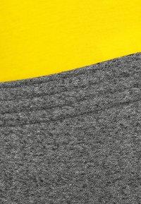 Champion - CUFF PANTS - Tracksuit bottoms - mottled dark grey - 4