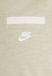 Nike Sportswear - T-shirt basic - grain/coconut milk/white - 6