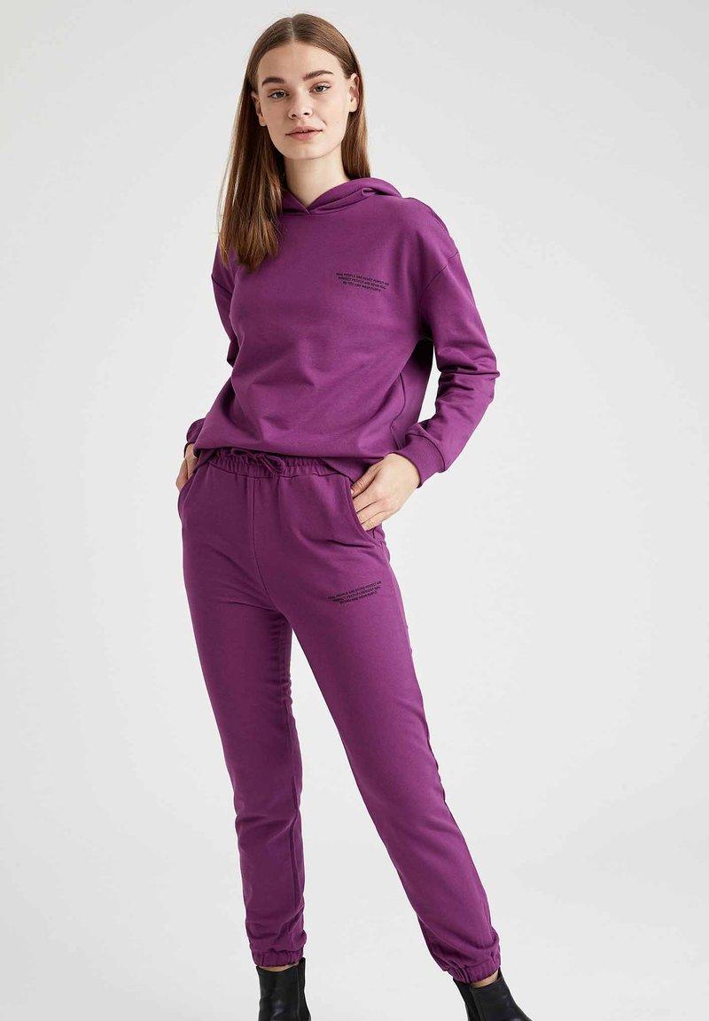 DeFacto - Tracksuit bottoms - purple