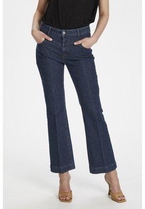 Flared Jeans - dark rinse denim