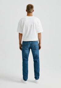 PULL&BEAR - Straight leg jeans - mottled light blue - 2