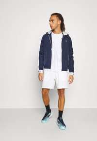 Lacoste Sport - TRACK JACKET - Träningsjacka - navy blue/ruby/white/navy blue - 1