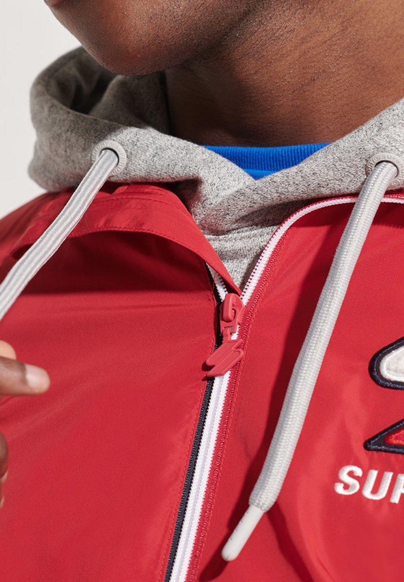 Superdry - CAGOULE - Training jacket - varsity red