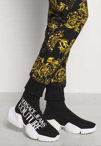 Versace Jeans Couture - PANTS - Tracksuit bottoms - black/gold - 4