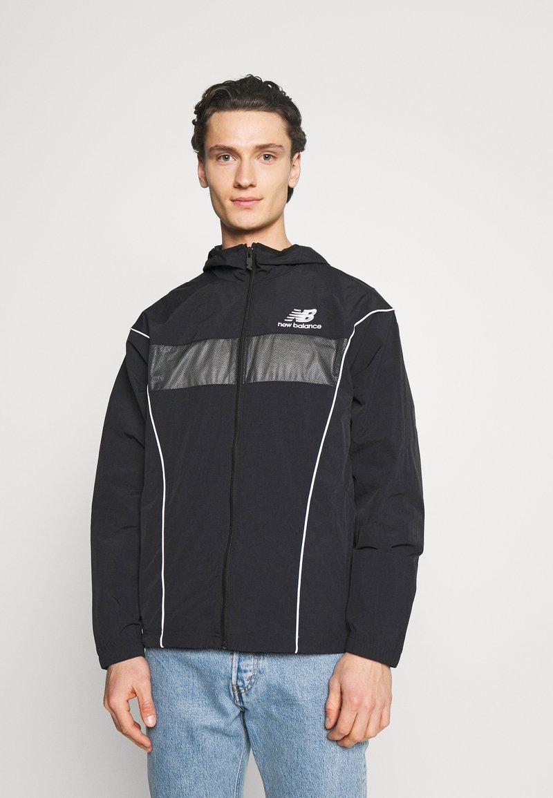 New Balance - ATHLETICS WINDBREAKER - Summer jacket - black