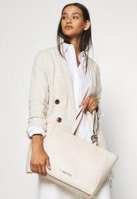 Calvin Klein - CHAIN SHOPPER - Handbag - beige - 1