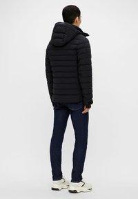 J.LINDEBERG - TODD  - Down jacket - black - 2