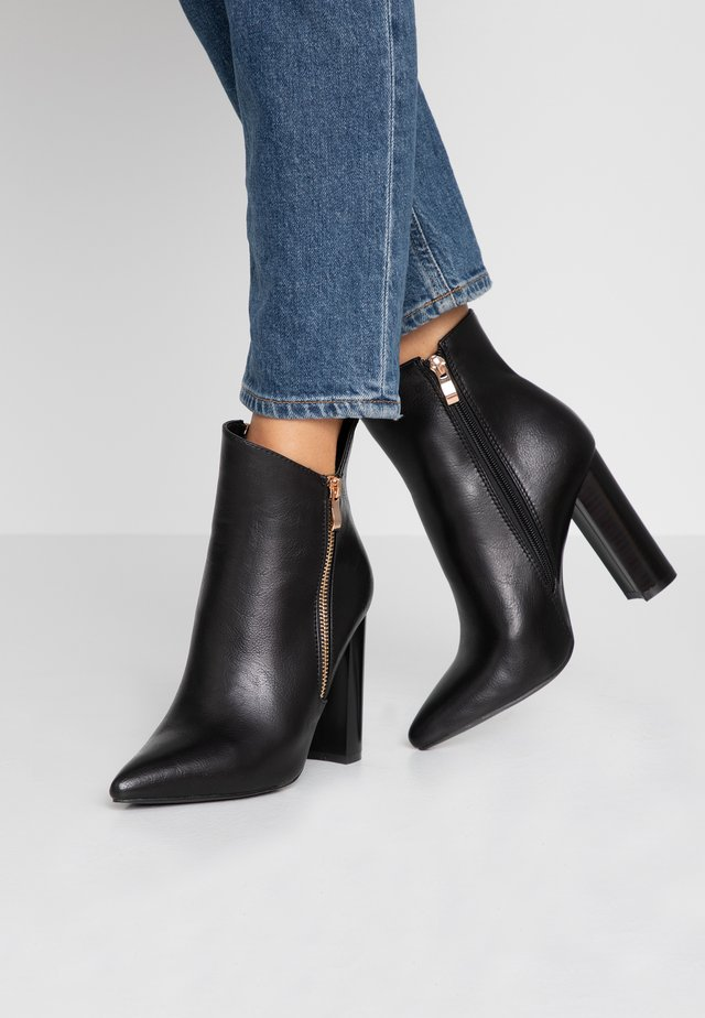 KEYLA - High heeled ankle boots - black