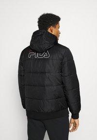 Fila - LASSE PUFFED JACKET - Winter jacket - black - 2