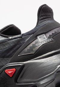 Salomon - SUPERCROSS BLAST GTX - Trail running shoes - black - 5