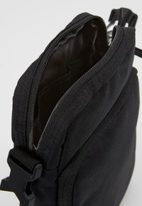Nike Sportswear - HERITAGE UNISEX - Across body bag - black - 4