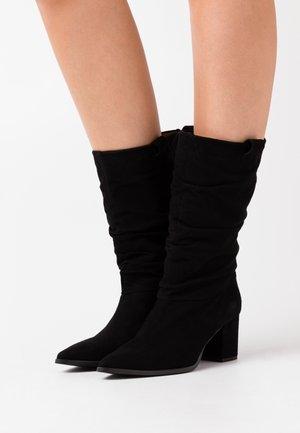 BENETTBO - Vysoká obuv - black
