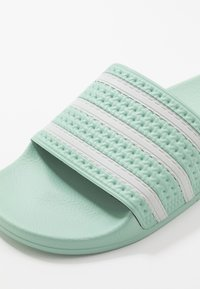 adidas Originals - ADILETTE - Pantofle - green