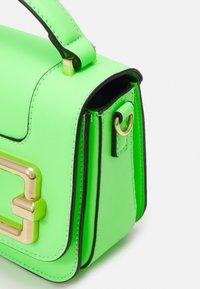 ALDO - LOTHAREWEN - Handbag - neon green - 4