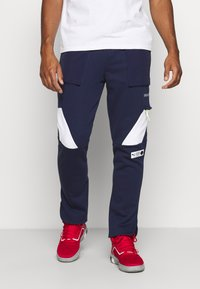 Puma - PARQUET - Pantalon de survêtement - peacoat - 0