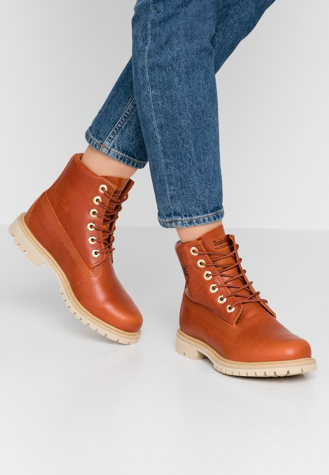 PANINARA COLLARLESS  - Lace-up ankle boots - rust