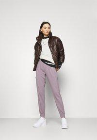 Nike Sportswear - AIR PANT - Tracksuit bottoms - purple smoke/white - 1