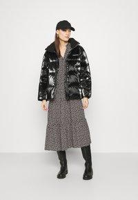 Calvin Klein Jeans - HIGH SHINE PUFFER - Winter jacket - ck black - 1