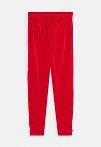 adidas Originals - ADICOLOR PRIMEGREEN PANTS - Pantalones deportivos - scarle/white - 1