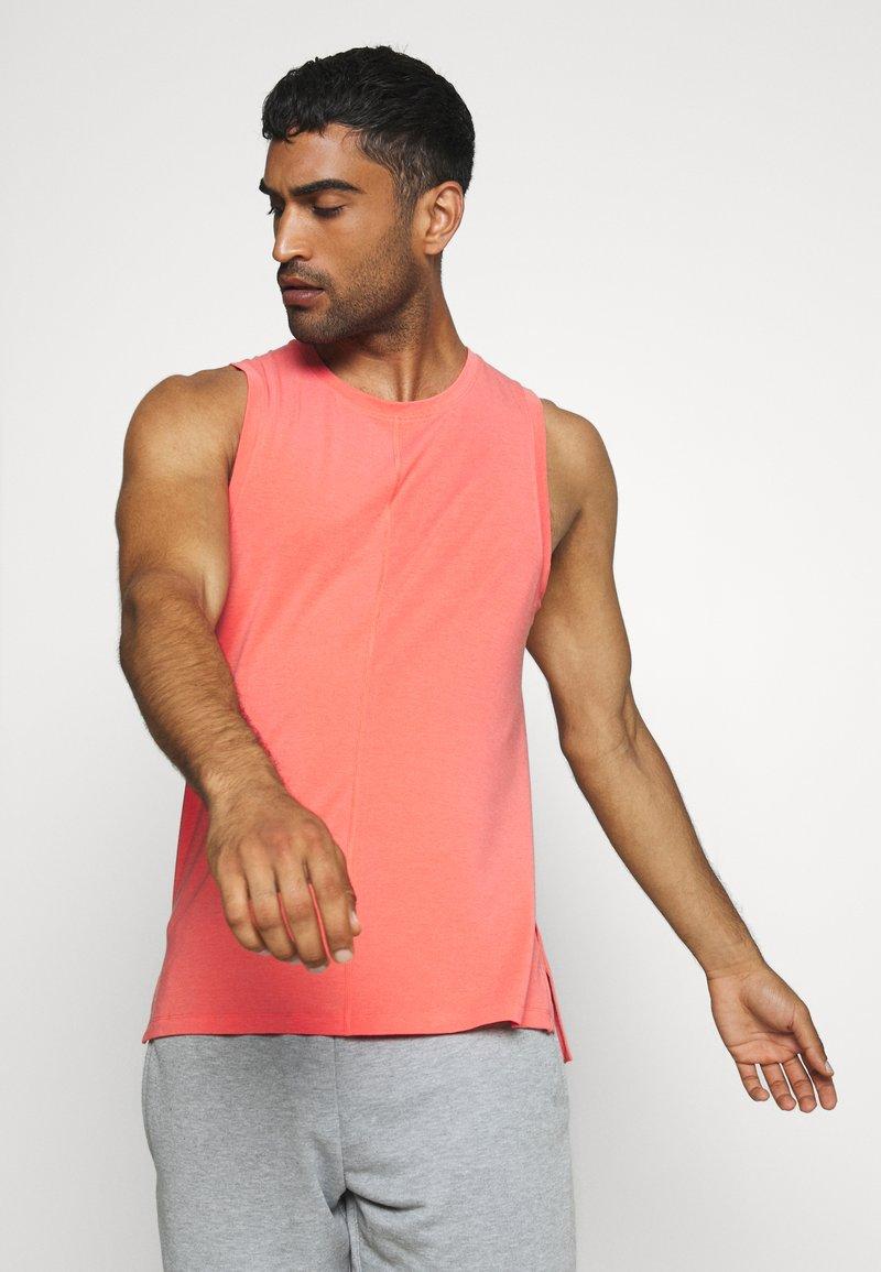 Nike Performance - DRY TANK YOGA - Sports shirt - magic ember/black