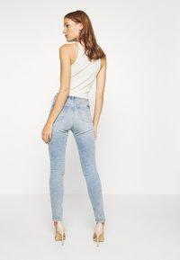 Calvin Klein Jeans - HIGH RISE SKINNY - Jeans Skinny - light blue - 2