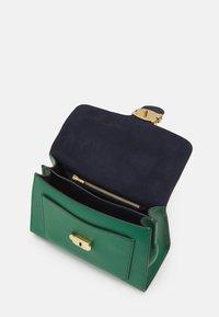 Coach - COVERED CLOSURE TABBY TOP HANDLE - Handbag - green - 2