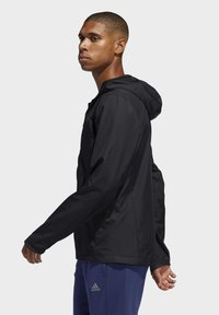 adidas Performance - OWN THE RUN HOODED WINDBREAKER - Training jacket - black - 3