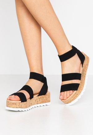 RICO - Sandály na platformě - black