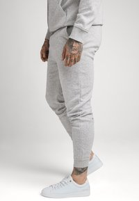 SIKSILK - MUSCLE FIT JOGGER - Tracksuit bottoms - grey marl - 4