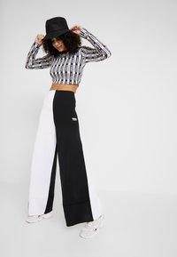 adidas Originals - PANT - Träningsbyxor - black/white - 1