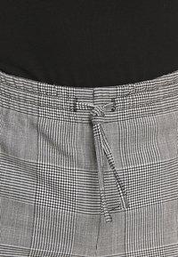 WRSTBHVR - SMART JOGGER - Kalhoty - black - 3