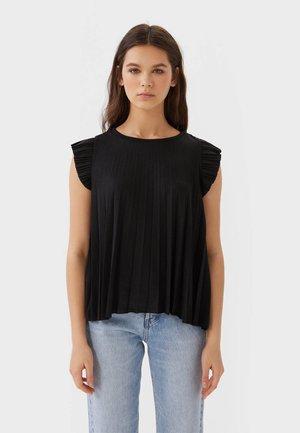 MIT VOLANT  - Bluse - black