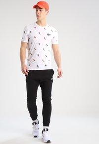 Nike Sportswear - CLUB JOGGER - Tracksuit bottoms - black - 1