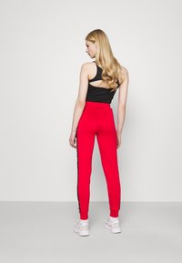 SIKSILK - CHASER TRACK PANT - Tracksuit bottoms - red - 2