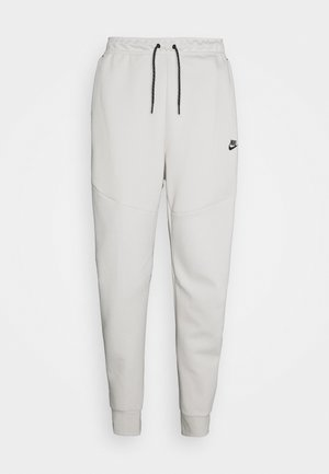 M NSW TCH FLC JGGR - Tracksuit bottoms - light bone/black