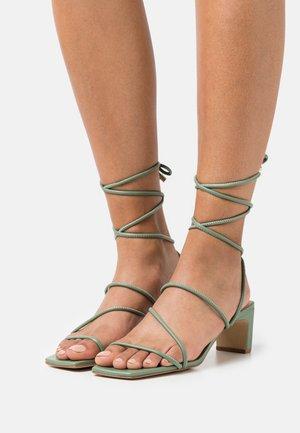 TEFFIP - Sandals - green