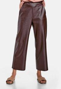 Gerry Weber - Trousers - dark chestnut - 0