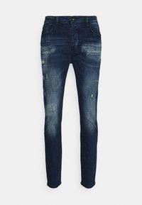 OSCARDENIM - Slim fit jeans - blue wash