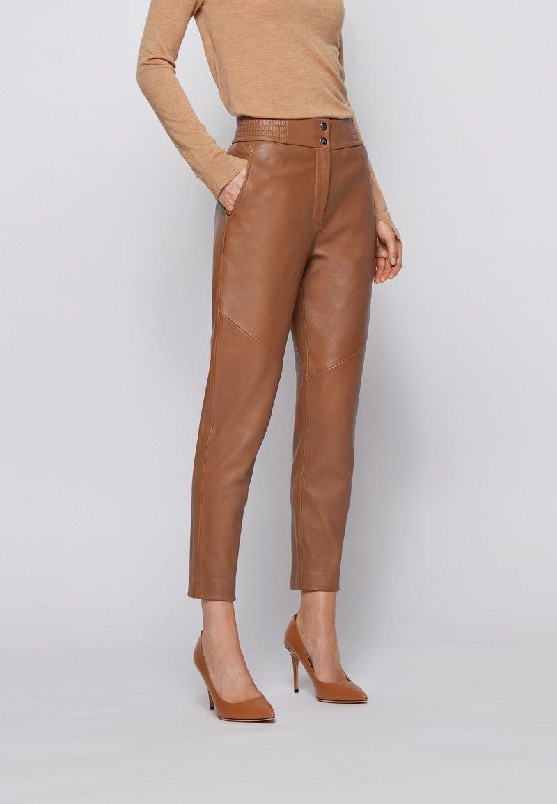 BOSS - SIWETTA - Trousers - light brown