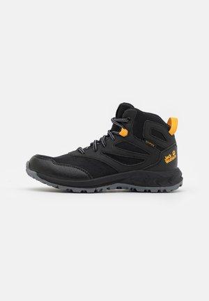 WOODLAND TEXAPORE MID UNISEX - Hiking shoes - black/burly yellow