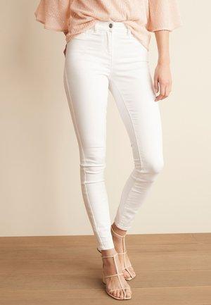 POWER STRETCH - Slim fit jeans - white