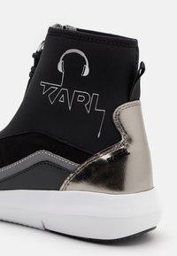 KARL LAGERFELD - VITESSE SOCK ZIP REFLECTIVE - High-top trainers - black/white/silver - 6