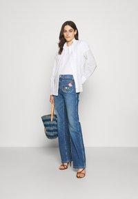 Polo Ralph Lauren - JENN FULL LENGTH FLARE - Bootcut jeans - blue - 1