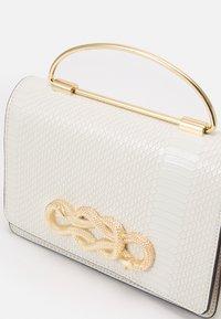 ALDO - SPRIMONT - Handbag - bright white/gold-coloured - 3