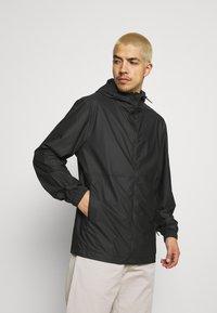 Rains - ULTRALIGHT JACKET UNISEX - Waterproof jacket - black - 0